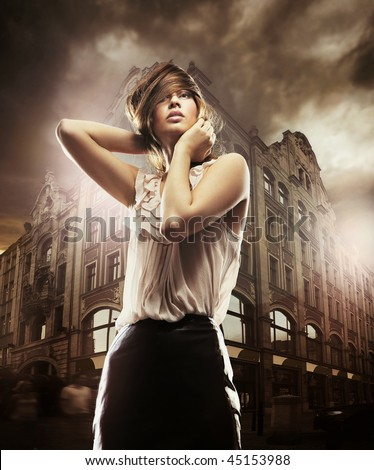 Fine art photo of a beautiful woman in front of a building