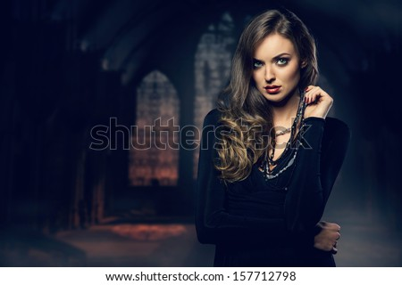 Fine art photo of a fashion lady at castle - stock photo