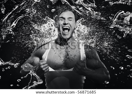 Fine art photo of a young strongman screaming - stock photo