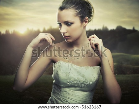 Fine art photo - young lady wearing a necklace of morning dew - stock photo