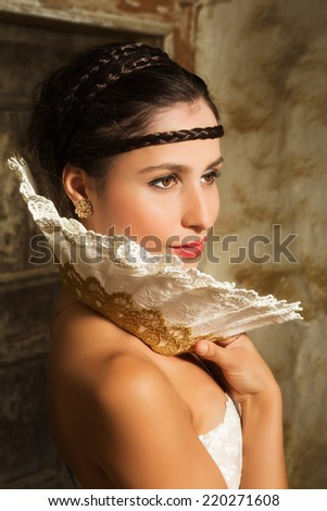 Fine art renaissance portrait of a woman wearing a lace collar in the style of the old masters - stock photo