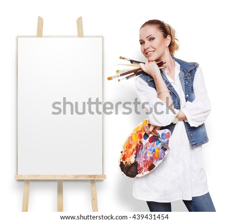 Fine art. Woman artist isolated at white. Girl painter with brushes and palette. Empty picture canvas at easel with copy space. Happy artist. Art classes for adults, education concept. - stock photo
