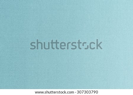 Fine authentic silk fabric wallpaper texture pattern background in shiny cyan blue green turquoise color tone: Thai silk detail pattern textured backdrop in light blue toned colour  - stock photo
