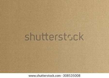 Fine authentic silk fabric wallpaper texture pattern background in shiny dark yellow gold brown color tone: Thai silk detail pattern textured backdrop in yellow tan creme beige brown toned colour  - stock photo