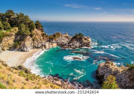 Fine beach and falls, Pacific coast,  Julia Pfeiffer beach, Big Sur. California, USA - stock photo