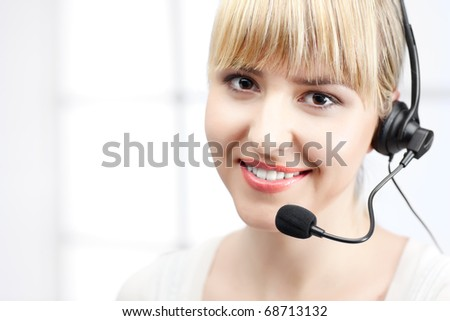 fine beautiful woman  with headphones in office