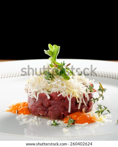 Fine dining, beef fillet tartare with horseradish - stock photo