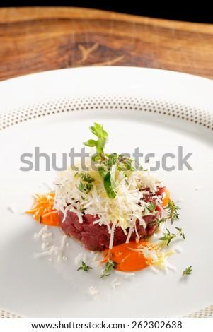 Fine dining, beef fillet tartare with horseradish - stock photo