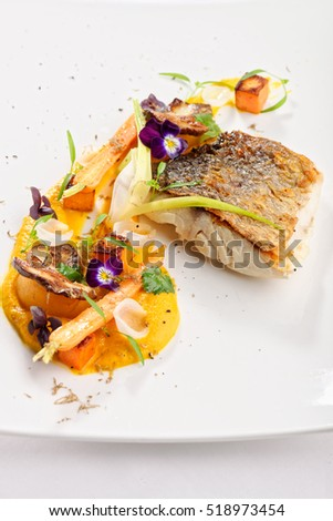 Fine dining, fish fillet breaded in herbs and spice on vegetable