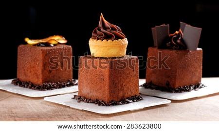 Fine dining, French dark chocolate gourmet mignon cakes - stock photo