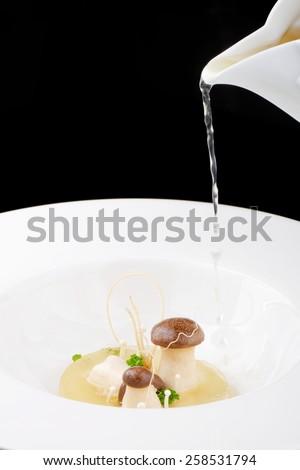 Fine dining, mushroom Porcini soup in a gourmet restaurant - stock photo