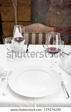 Fine dining restaurant/Dinner table place setting. - stock photo