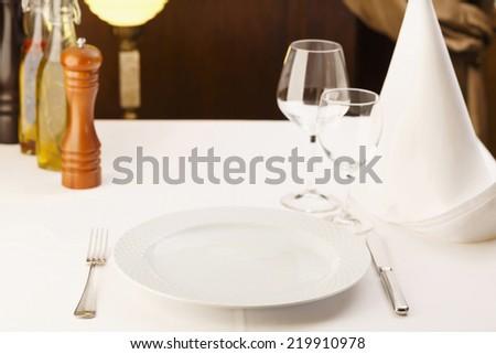 Fine dining restaurant. Dinner table place setting/Restaurant serving table - stock photo
