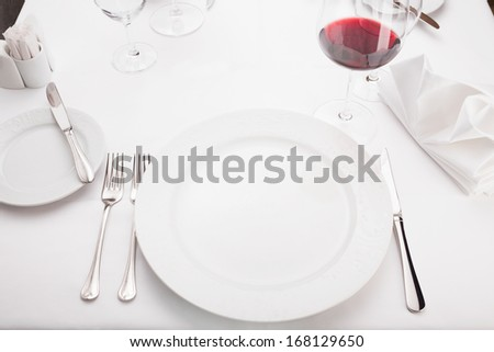 Fine dining restaurant/Fine dining restaurant. Dinner table place setting. - stock photo