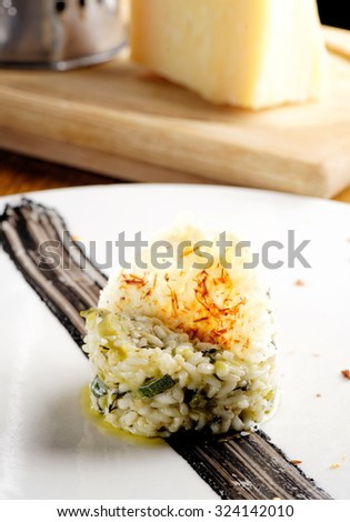 Fine dining risotto with asparagus and zucchinis with parmesan cheese - stock photo