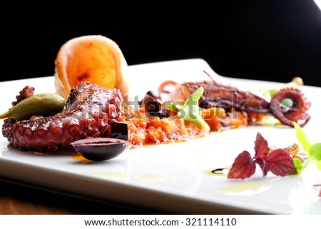 Fine dining seafood appetizer on a restaurant table - stock photo