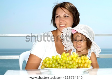 Fine famile  on the balcony of their hotel - stock photo