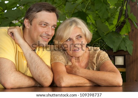 Fine family sitting at a table on the veranda