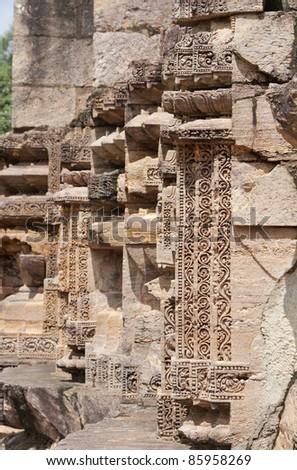 Fine floral intricate carvings on pillar, Sun temple Konarak - stock photo