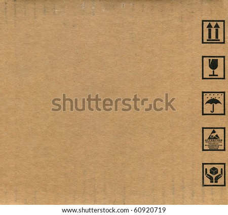 Fine image close-up of grunge black fragile symbol on cardboard - stock photo