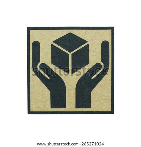 Fine image close-up of grunge black fragile symbol on cardboard on white background - stock photo