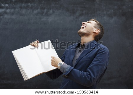 fine image of young caucasian teacher at school - stock photo