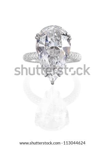 Fine jewelry: large pear shaped diamond engagement ring isolated on white background. - stock photo