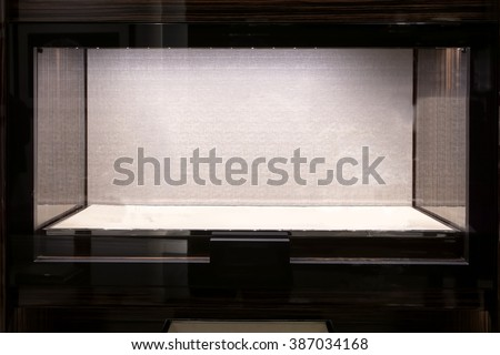 Fine panoramic empty glass showcase display for luxury product - stock photo