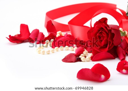 fine pearl beads and red roses petals - stock photo