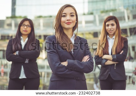 fine portrait of three young business women. concept about teamwork, business and finance - stock photo