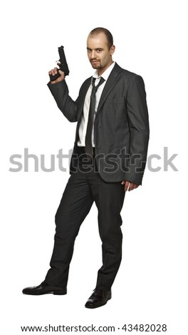fine portrait of young caucasian man holdin a pistol isolate on white background - stock photo