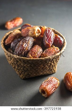 Fine quality arabic dates arranged in an earthen bowl. - stock photo