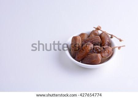 Fine quality Arabic dates on white bowl