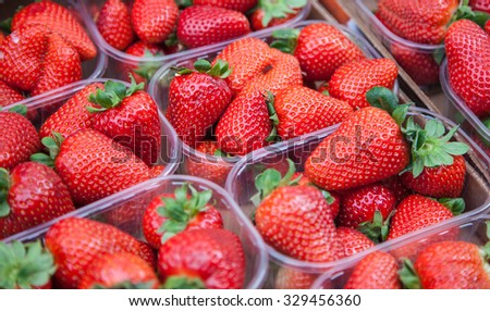 Fine ripe strawberries at market stall