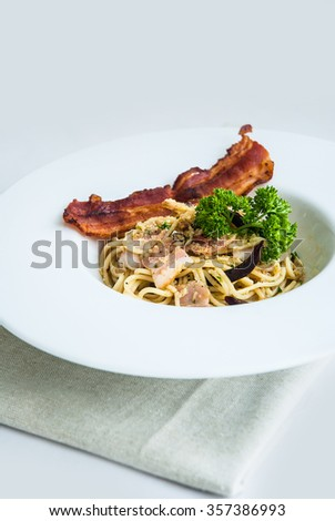 Fine spaghetti bacon and cheese with  parsley .selective  focus
