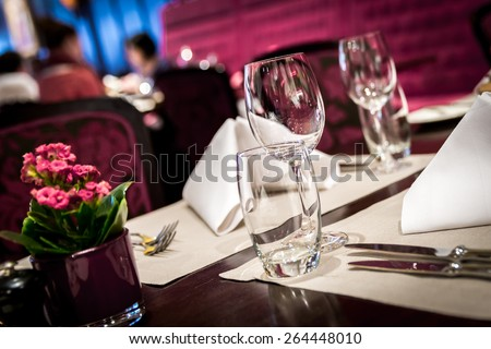 Fine table setting in a luxurious restaurant - stock photo