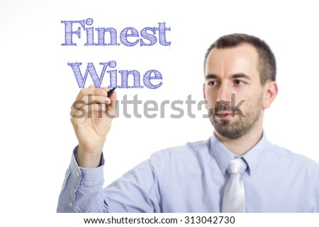 Finest Wine - Young businessman writing blue text on transparent surface - stock photo