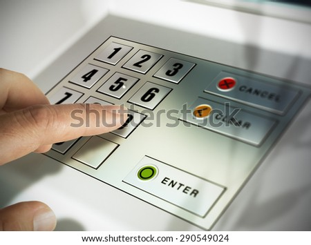 Finger about to press a pin code on a pad. Security code on an Automated Teller Machine, ATM - stock photo