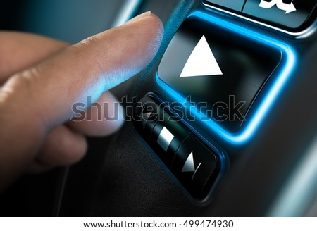 Finger about to press a play button on a home sound system interface. Black background and blue light. Composite between a photography and a 3D background. Horizontal image
