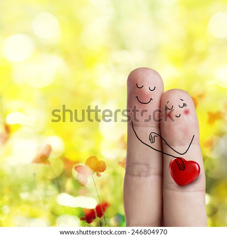 Finger art. Lovers is embracing and holding red heart Happy Valentine's Day and 8 March love theme series. Painted fingers There are path in image. You can easily cut out fingers from the background.  - stock photo