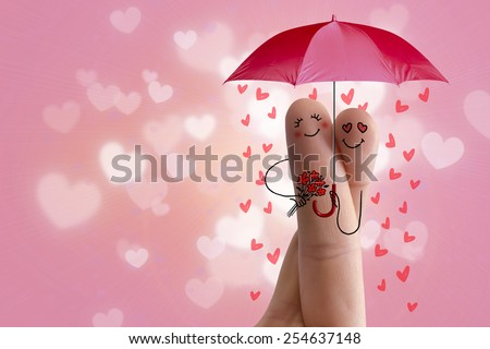Finger art. Lovers is embracing and holding red umbrella. Stock Image. Happy Valentine's Day, wedding and 8 March creative and fun love series. Painted fingers in love - stock photo
