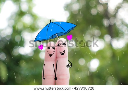 Finger art of a Happy couple. A man and a woman hug with pink hearts in the eyes. The concept of love at first sight.rainy season