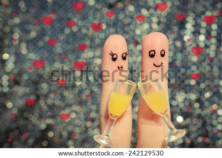 Finger art of a Happy couple. Couple making good cheer. Two glasses of champagne. Valentine's day. Toned image.  - stock photo