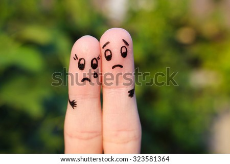 Finger art of  displeased couple. Sad man soothe woman, she's crying. - stock photo