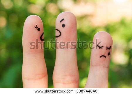 Finger art of family during quarrel. The concept of parents quarrel, child was upset. - stock photo