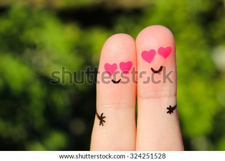 Finger art of Happy couple. Man and woman hug with pink hearts in eyes. Concept of love at first sight.  - stock photo