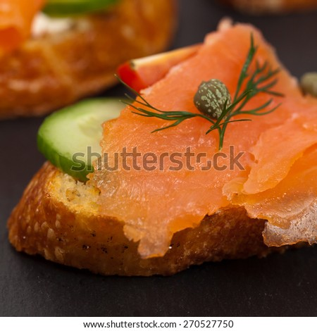 Finger food canapes with smoked salmon and cream cheese. Selective focus. - stock photo