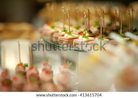 finger food serve on glasses slate platter - stock photo