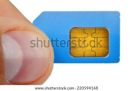 finger holding sim card isolated on white background - stock photo