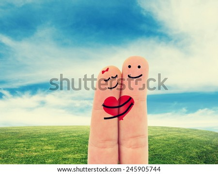finger in love on nature  - stock photo